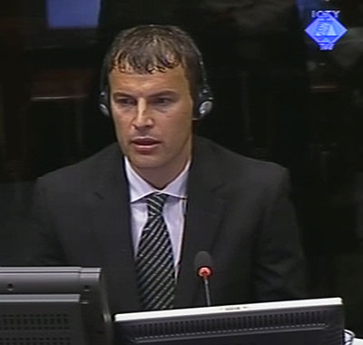 Elvedin Pasic giving testimony in the court room in The Hague, Netherlands.