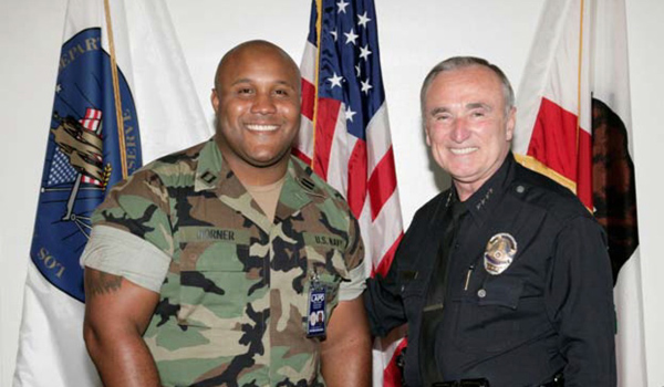 Christopher Dorner, left, with then-LAPD Chief William J. Bratton, in a photo from the August 2006 issue of the Beat police newsletter.