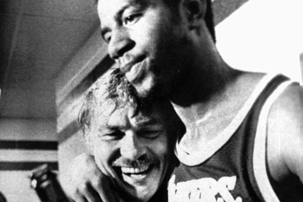 Magic Johnson hugs Lakers owner Jerry Buss in the locker room after the team won the 1980 NBA championship.