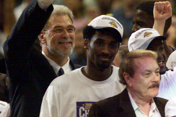 Phil Jackson, Kobe Bryant and Jerry Buss celebrate the Lakers' win in Game 6 of the NBA Finals at Staples Center in 2000.