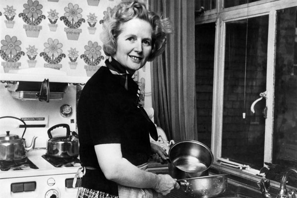 British Conservative Party leader Margaret Thatcher, then 49, posing in the kitchen of her Chelsea home in London following her election at the head of the Tory.