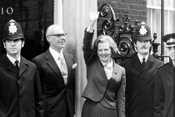 Margaret Thatcher waving as she arrives to take office at 10 Downing Street in London.
