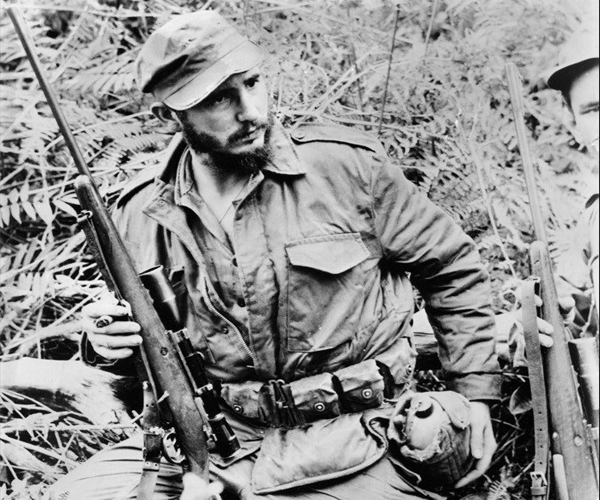Fidel Castro stands with his double-triggered rifle in this undated photo, received by The Times in 1958.