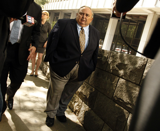 Robert Rizzo leaves the L.A. courthouse where he was sentenced with orders to report to prison the next month.