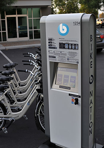 Bicycles will be available to borrow or rent at hundreds of kiosks similar to this one.