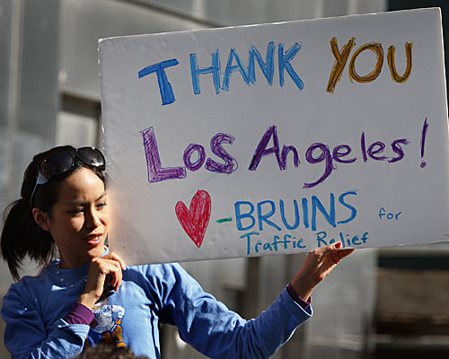 UCLA graduate student and Bruins for Traffic Relief club member Sirinya Tritipeskul holds a sign at a news conference noting voter approval of Measure R.