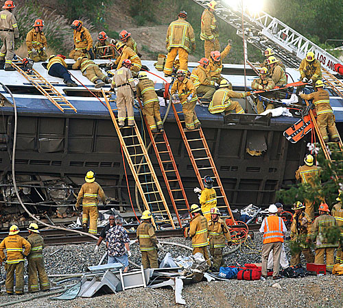 Fire and emergency personnel work to free passengers who were trapped when a Metrolink commuter train collided head-on with a Union Pacific freight train in Chatsworth.