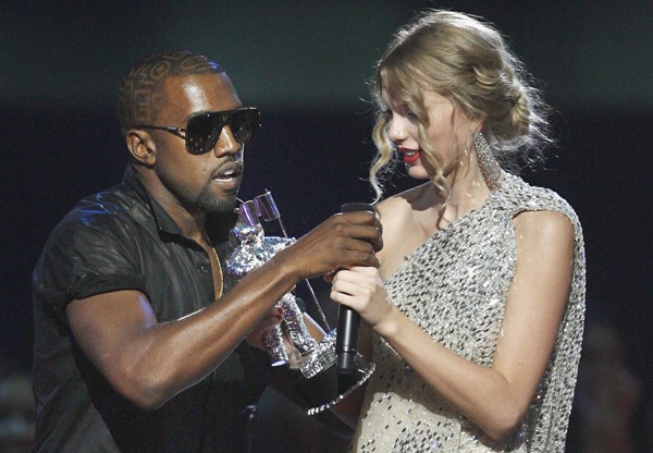 Rapper Kanye West takes the microphone from singer Taylor Swift as she accepts the best female video award during the 2009 MTV Video Music Awards.