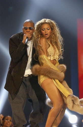 Jay Z and Beyoncé perform onstage during the 2003 MTV Video Music Awards.