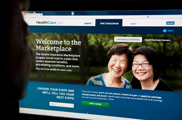 A woman looks at the HealthCare.gov insurance exchange site.
