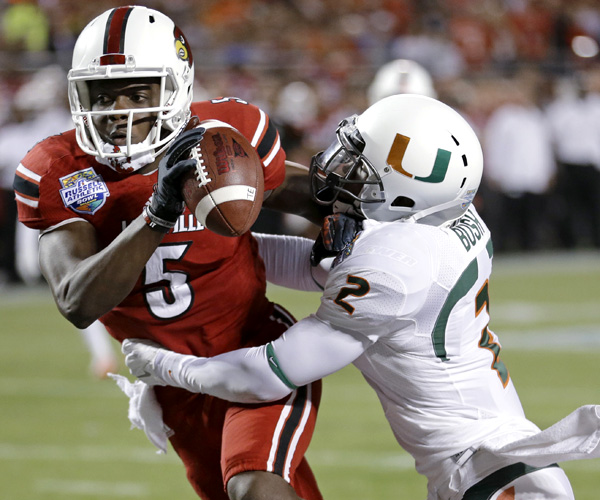Although Miami defensive back Deon Bush sacked Louisville quarterback Teddy Bridgewater in the end zone for a safety on this play in the first half, Bridgewater passed for three touchdowns to lead the Cardinals to a 36-9 victory in the Russell Athletic Bowl.