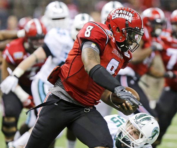Louisiana-Lafayette quarterback Terrance Broadway gets around Tulane safety Sam Scofield during the Ragin' Cajuns' victory over the Green Wave, 24-21, in the New Orleans Bowl.
