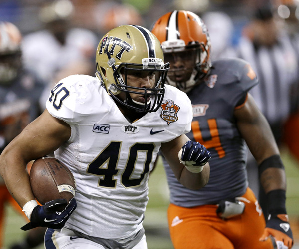 Pittsburgh running back James Conner, who rushed for 229 yards, breaks into the Bowling Green secondary on a run in the second half. Pitt won the game, 30-27.