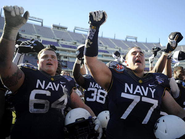 Navy players celebrate their 24-6 victory over Middle Tennessee State in the Armed Forces Bowl.