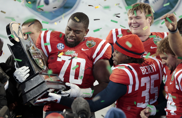 Mississippi offensive lineman Emmanuel McCray, left, and defensive back Ontario Berry celebrate their 25-17 victory over Georgia Tech in the Music City Bowl in Nashville, Tenn.