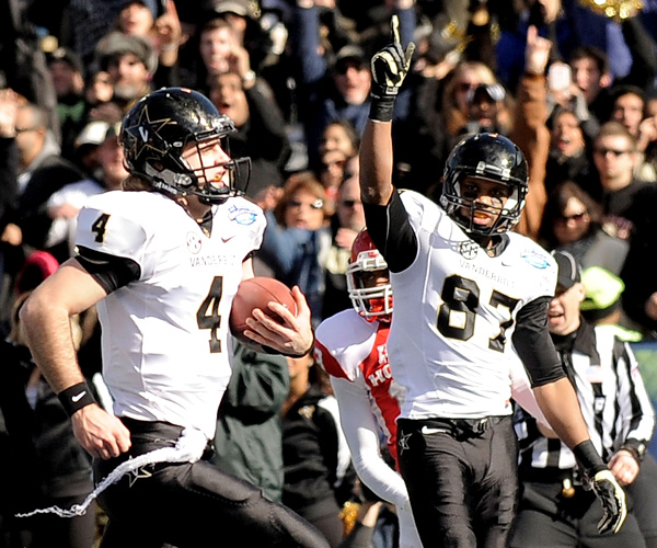 Vanderbilt receiver Jordan Matthews (87) reacts as quarterback Patton Robinette scores a touchdown against Houston in the BBVA Compass Bowl. Robinette and Matthews connected for two 50-yard scoring pass plays in a 41-24 victory.