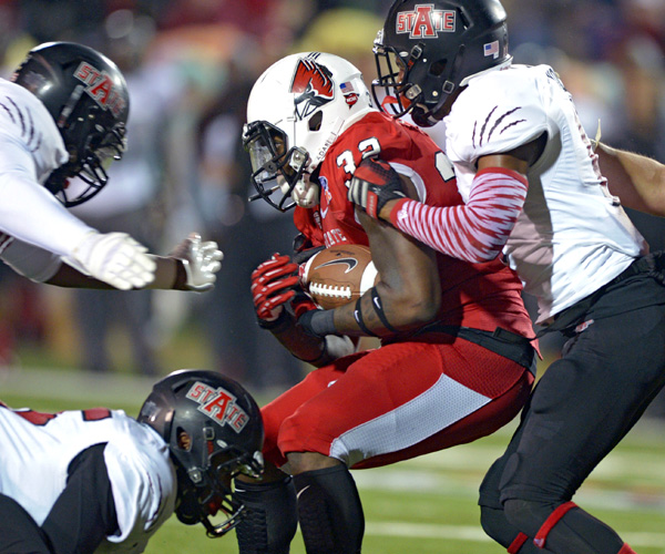 Ball State running back Jahwan Edwards is stopped by Arkansas State defensive back Sterling Young in the first half of the GoDaddy Bowl. Backup quarterback Fredi Knighten threw a 13-yard pass to Allen Muse with 32 seconds left to lift Arkansas State to the win.