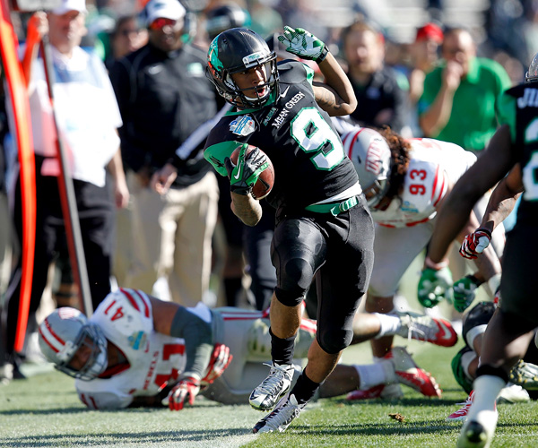 North Texas receiver Carlos Harris can't avoid stepping out of bounds after a reception against UNLV in the first half of the Heart of Dallas Bowl. Derek Thompson threw for 256 yards and two touchdowns while Brelan Chancellor had two touchdown runs in the fourth quarter for the Mean Green.