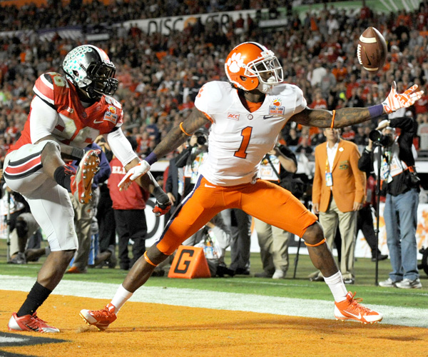 Clemson receiver Martavis Bryant makes a juggling touchdown catch against Ohio State cornerback Armani Reeves to put the Tiger ahead in the third quarter of the Orange Bowl. Clemson's Tajh Boyd threw for 378 yards and five touchdowns while Sammy Watkins had a record-setting night with 16 catches for 227 yards and two touchdowns.