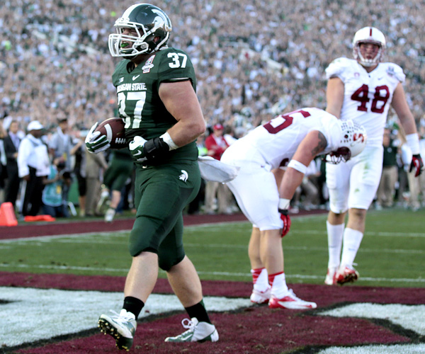 Michigan State fullback Trevon Pendleton celebrates after scoring on a two-yard touchdown pass against Stanford late in the first half of the Rose Bowl. The Spartans fell behind by 10 points early in the game before rallying in the second half for the victory.
