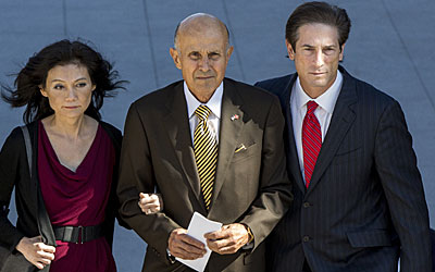 Lee Baca, center, his wife Carol, and his attorney Nathan Hochman, leave the Los Angeles Federal Courthouse.