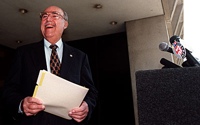 Sheriff Sherman Block, outside Sheriff's Department headquarters, talks to reporters and offers to debate Lee Baca. (July 16, 1998)