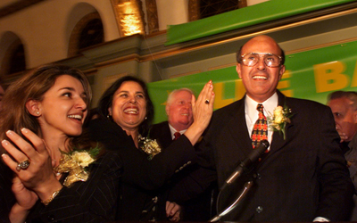 Lee Baca is congratulated by his sister Elaine Baca Wagner, center, and supporter, Nadia Nalbandian, left, as he prepares to make his victory speach at the Ritz Calton in Pasadena. (Nov. 3, 1998)