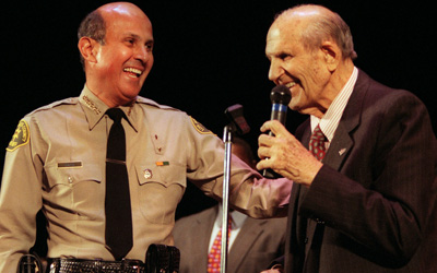 Baca laughs with former L.A. County Sheriff Peter Pitchess shortly after the swearing in ceremony in Pasadena.