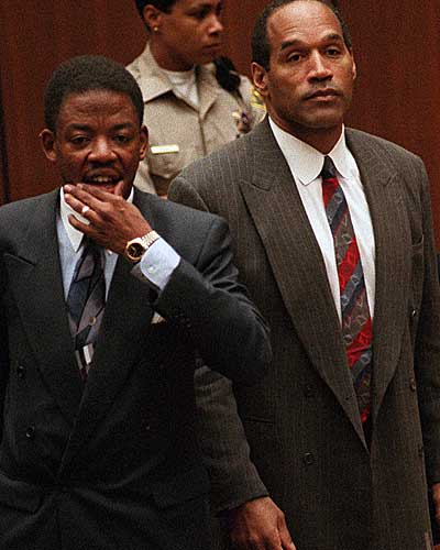 O.J. Simpson stands with attorney Carl Douglas as the jury enters the courtroom to announce that it had reached a verdict in the double-murder trial.