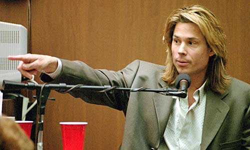 "Brian ""Kato"" Kaelin points to double-murder defendant O.J. Simpson during testimony."