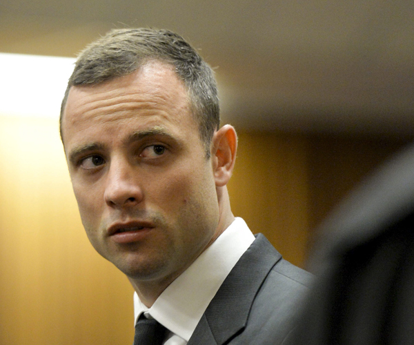 Pistorius stands in court on the first day of his trial.