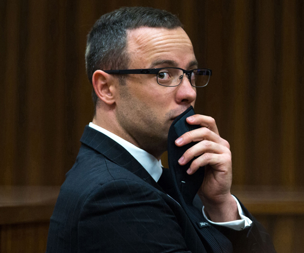 Pistorius looks on as evidence is presented in his trial.