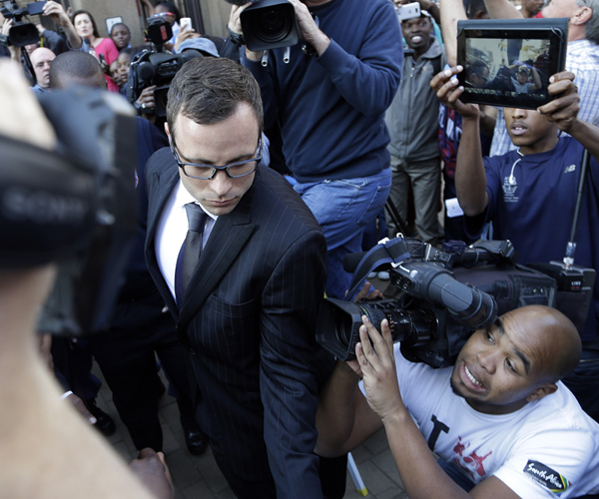 Pistorius is surrounded by reporters and onlookers as he leaves the high court in Pretoria.