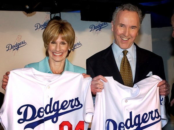 Then married Jamie and Frank McCourt hold Los Angeles Dodgers jerseys after announcing in 2004 that Major League Baseball had approved the purchase of the Dodgers.