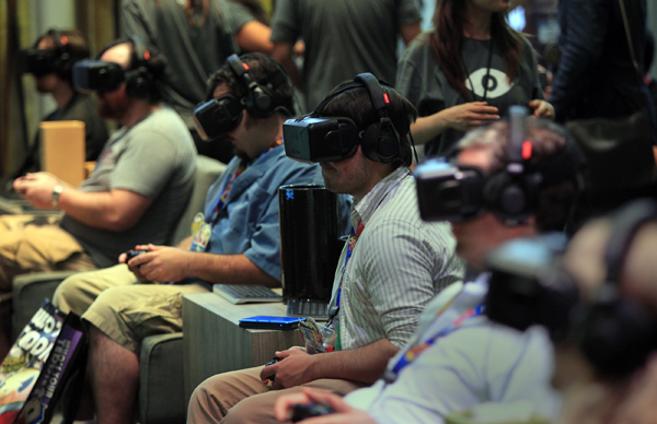 Attendees try out the Oculus Rift 2 during E3 2014.