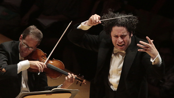 L.A. Philharmonic music director Gustavo Dudamel conducts the orchestra during a performance at Walt Disney Concert Hall on Oct. 2, 2014.