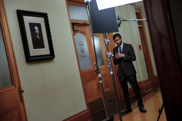 "Aziz Ansari on the set of ""Parks and Recreation"" in 2013."