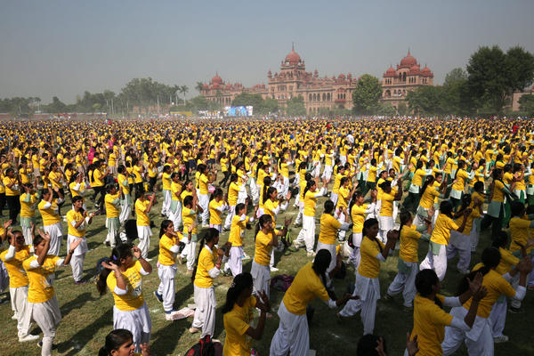 School children perform to attempt to enter the Guinness Book of World Records for a five-minute synchronized performance with the largest gathering of participants, at Khalsa College in Amritsar, India in October 2015.