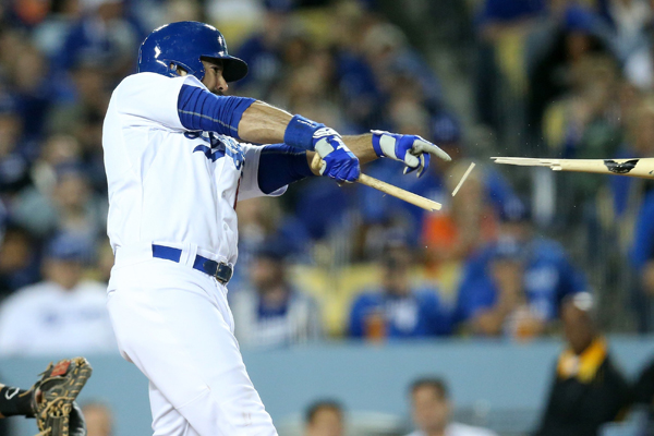 Dodgers right fielder Andre Ethier breaks his bat on a two-run single in the sixth inning of an 11-1 victory over the Miami Marlins.
