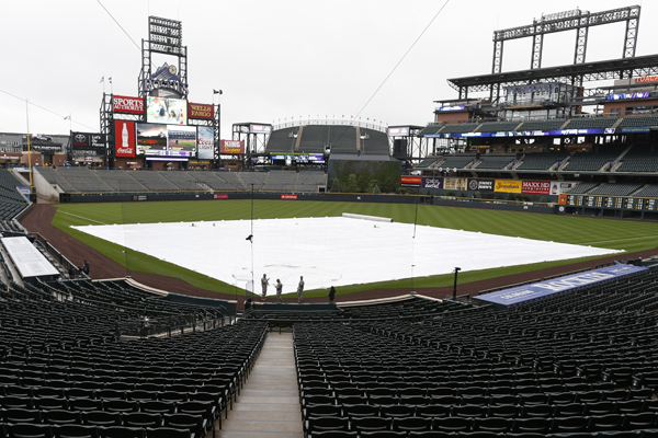 A tarp covers the infield at Coors Field following the cancellation of the Dodgers-Rockies game on May 9, 2015.