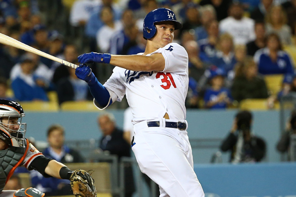 Dodgers center fielder Joc Pederson hits a run-scoring double during the third inning of a win over the San Francisco Giants.