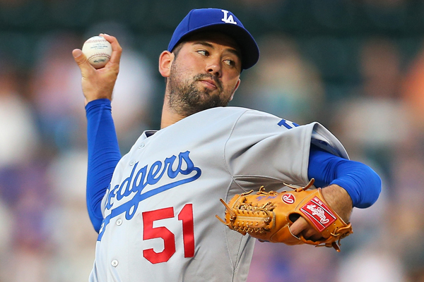 Dodgers starter Zach Lee delivers a pitch during the first inning of a 15-2 loss to the New York Mets.