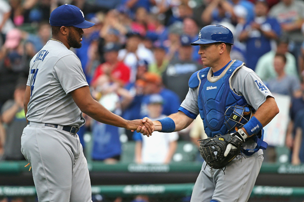 Dodgers closer Kenley Jansen, left, and catcher A.J. Ellis shake hands after a 4-0 victory over the Chicago Cubs.