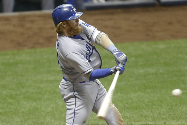 Dodgers third baseman Justin Turner hits a three-run home run during the sixth inning of a win over the Milwaukee Brewers.