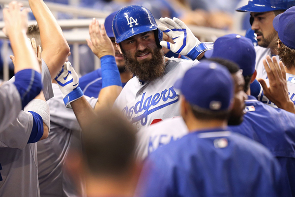Dodgers outfielder Scott Van Slyke celebrates in the dugout after hitting a two-run home run during the second inning of a 7-1 win over the Miami Marlins.