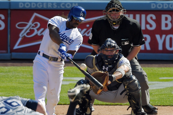 Dodgers shortstop Jimmy Rollins hits a three-run home run off San Diego Padres reliever Shawn Kelley during the eighth inning of the Dodgers' opening day win.