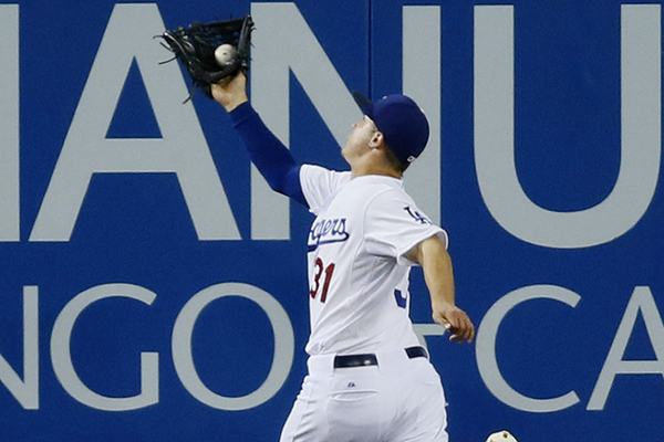 Dodgers center fielder Joc Pederson makes a running catch during the ninth inning of an 8-0 win over the Arizona Diamondbacks.