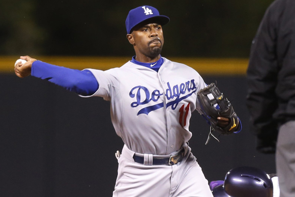 Dodgers shortstop Jimmy Rollins turns a double play during the first inning of a win over the Colorado Rockies.