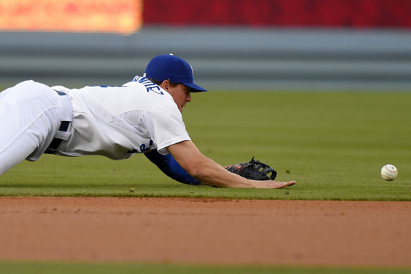 Dodgers shortstop Enrique Hernandez can't stop a single by St. Louis' Jhonny Peralta during the first inning of the Dodgers' loss.