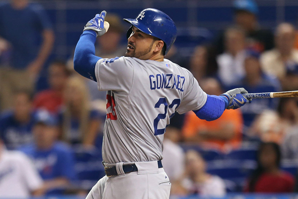 Dodgers first baseman Adrian Gonzalez hits a run-scoring single during the fourth inning of a 3-2 loss to the Miami Marlins.
